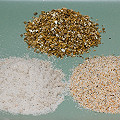 Two grades of sand and vermiculite (rear).